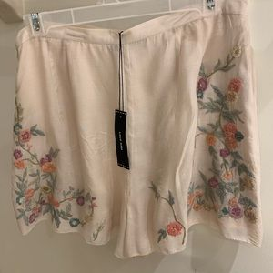 LOVE SAM nude floral shorts